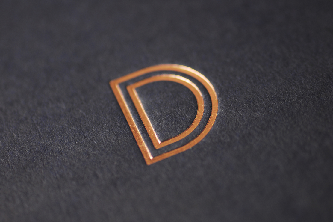 Bronze foil on Imperial Blue Colorplan from GF Smith